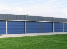 Multiple Use Aircraft Hangar With Large Opening
