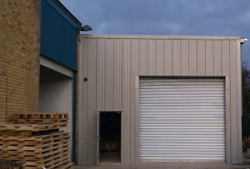 Steel extension to existing storage building