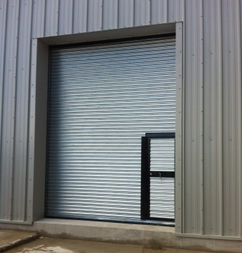 Roller shutter door with wicket gate