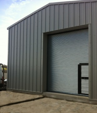 MiracleLite Steel Building with wicket gate in roller shutter door