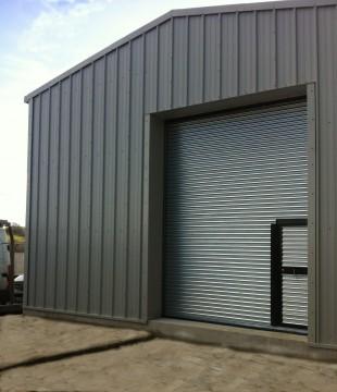 MiracleLite Steel Building with wicket gate in roller shutter door