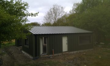 Scout hut finished in green to blend in with surroundings